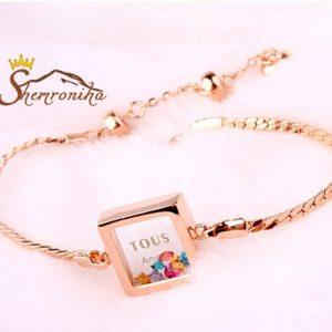 دستبند با آویز شیشه ای حاوی کریستال های رنگی گلد (۱)